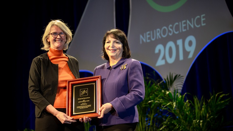 Huda Akil, PhD (right), of the University of Michigan, is honored with the Julius Axelrod Prize