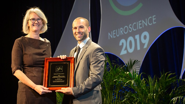 Brian M. Sweis, PhD (right), of the University of Minnesota, accepts the Donald B. Lindsley Prize in Behavioral Neuroscience.