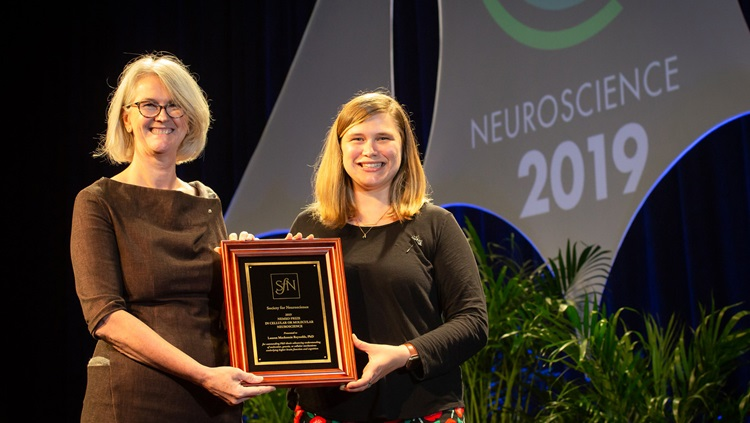 Lauren Mackenzie Reynolds, PhD (right), of Sorbonne Université accepts the Nemko Prize in Cellular and Molecular Neuroscience