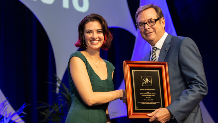 Teodora Stoica, MS, of the University of Louisville, accepts the Next Generation Award at the pre/postdoctoral level.