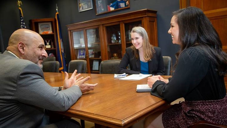 Two NeuroAdvocates in a meeting with a legislator at SfN Hill Day 2020