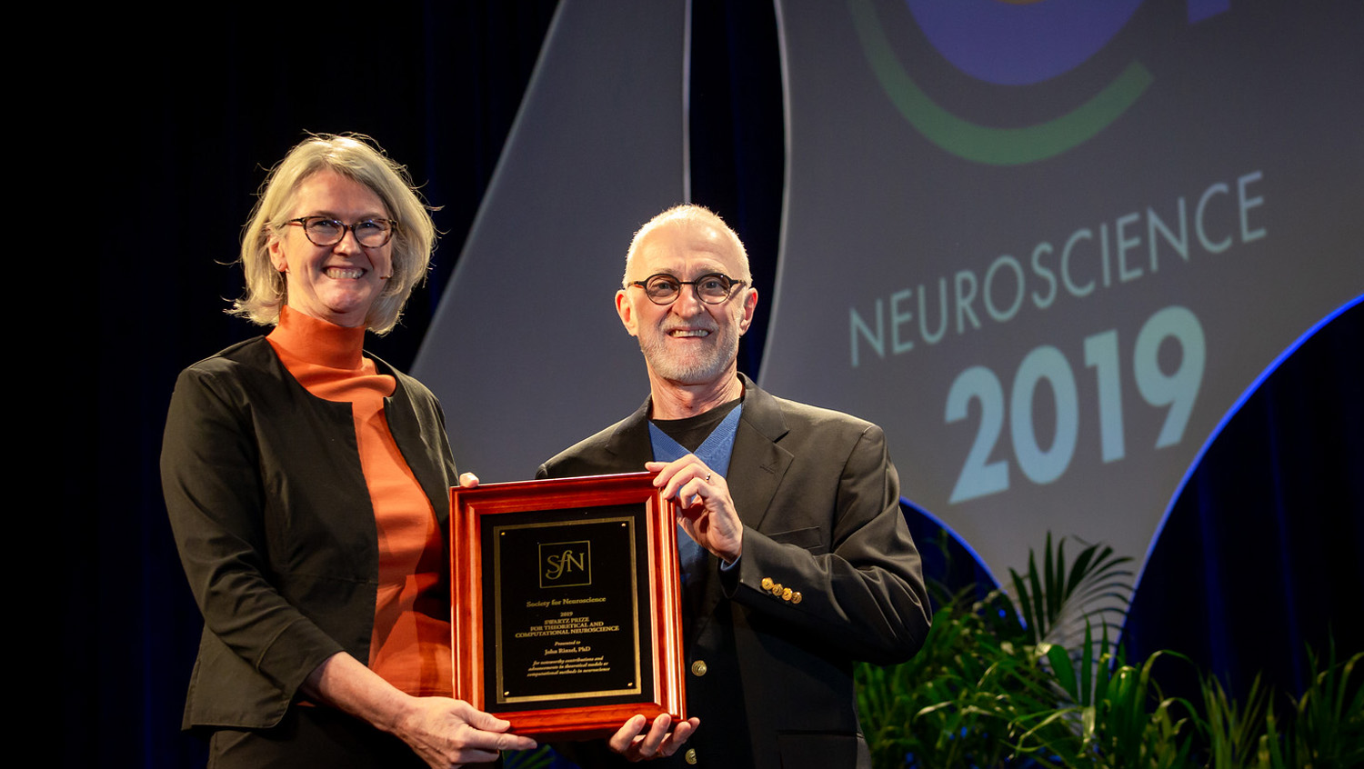 John Rinzel, PhD (right), of New York University, accepts the Swartz Prize for Theoretical and Computational Neuroscience